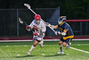 Baldwinsville Bees Michael Marsallo (29) with the ball against a West Genesee Wildcats defender in Section III Boys Lacrosse action at the Pelcher-Arcaro Stadium in Baldwinsville, New York on Tuesday, May 4, 2021. Baldwinsville won 11-4.