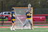 West Genesee Wildcats goalie Bryce Landry (12) makes a save against the Baldwinsville Bees in Section III Boys Lacrosse action at the Pelcher-Arcaro Stadium in Baldwinsville, New York on Tuesday, May 4, 2021. Baldwinsville won 11-4.