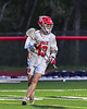 Baldwinsville Bees Keegan Lynch (13) looking to make a play against the West Genesee Wildcats in Section III Boys Lacrosse action at the Pelcher-Arcaro Stadium in Baldwinsville, New York on Tuesday, May 4, 2021. Baldwinsville won 11-4.