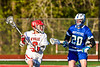 Baldwinsville Bees Victor Ianno (2) being defended by Cicero-North Syracuse Northstars Michael Koehler (20) in Section III Boys Lacrosse action at the Pelcher-Arcaro Stadium in Baldwinsville, New York on Tuesday, May 11, 2021. Baldwinsville won 17-6.