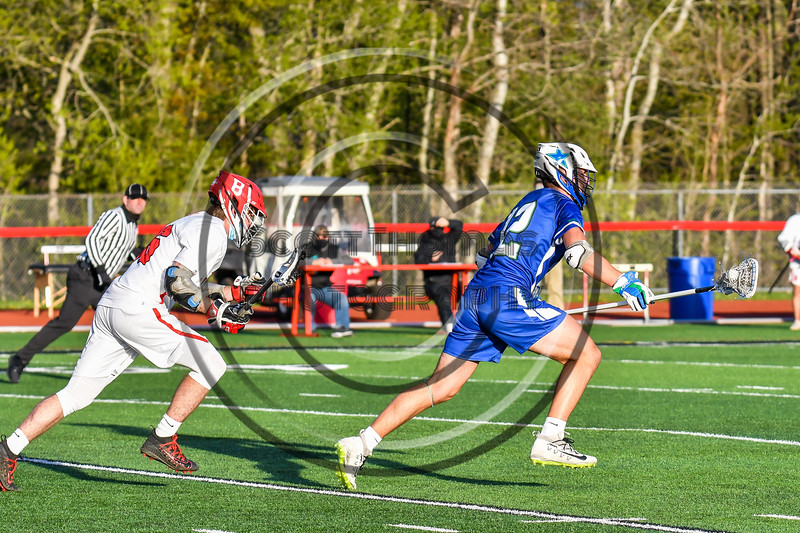 Cicero-North Syracuse Northstars Joshua Kubala (12) running with the ball against the Baldwinsville Bees in Section III Boys Lacrosse action at the Pelcher-Arcaro Stadium in Baldwinsville, New York on Tuesday, May 11, 2021. Baldwinsville won 17-6.