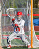 Baldwinsville Bees goalie Mason Clark (15) warming up before a Section III Boys Lacrosse game at the Pelcher-Arcaro Stadium in Baldwinsville, New York on Tuesday, May 11, 2021.