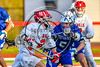 Baldwinsville Bees Victor Ianno (2) being defended by Cicero-North Syracuse Northstars Reynolds Davis (5) in Section III Boys Lacrosse action at the Pelcher-Arcaro Stadium in Baldwinsville, New York on Tuesday, May 11, 2021. Baldwinsville won 17-6.