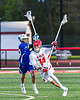 Baldwinsville Bees Tucker Macknik (14) protects the ball against a Cicero-North Syracuse Northstars player in Section III Boys Lacrosse action at the Pelcher-Arcaro Stadium in Baldwinsville, New York on Tuesday, May 11, 2021. Baldwinsville won 17-6.