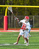 Baldwinsville Bees Brayden Penafeather-Stevenson (21) with the ball against the Cicero-North Syracuse Northstars in Section III Boys Lacrosse action at the Pelcher-Arcaro Stadium in Baldwinsville, New York on Tuesday, May 11, 2021. Baldwinsville won 17-6.