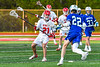 Baldwinsville Bees Brayden Penafeather-Stevenson (21) defending against Cicero-North Syracuse Northstars Ian Leahey (22) in Section III Boys Lacrosse action at the Pelcher-Arcaro Stadium in Baldwinsville, New York on Tuesday, May 11, 2021. Baldwinsville won 17-6.