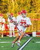 Baldwinsville Bees Trey Ordway (33) running with the ball against the Cicero-North Syracuse Northstars in Section III Boys Lacrosse action at the Pelcher-Arcaro Stadium in Baldwinsville, New York on Tuesday, May 11, 2021. Baldwinsville won 17-6.