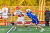 Baldwinsville Bees Trey Ordway (33) with the ball being defended by Cicero-North Syracuse Northstars Reynolds Davis (5) in Section III Boys Lacrosse action at the Pelcher-Arcaro Stadium in Baldwinsville, New York on Tuesday, May 11, 2021. Baldwinsville won 17-6.