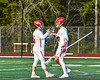 Baldwinsville Bees goalie Cooper Foote (5) greets Tucker Macknik (14) before the start of quarter against the Cicero-North Syracuse Northstars in Section III Boys Lacrosse action at the Pelcher-Arcaro Stadium in Baldwinsville, New York on Tuesday, May 11, 2021. Baldwinsville won 17-6.