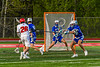 Baldwinsville Bees Colin Socker (26) scores a goal against Cicero-North Syracuse Northstars goalie Giovanni Heater (27) in Section III Boys Lacrosse action at the Pelcher-Arcaro Stadium in Baldwinsville, New York on Tuesday, May 11, 2021. Baldwinsville won 17-6.