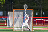 Baldwinsville Bees goalie Cooper Foote (5) makes a save against the Cicero-North Syracuse Northstars in Section III Boys Lacrosse action at the Pelcher-Arcaro Stadium in Baldwinsville, New York on Tuesday, May 11, 2021. Baldwinsville won 17-6.