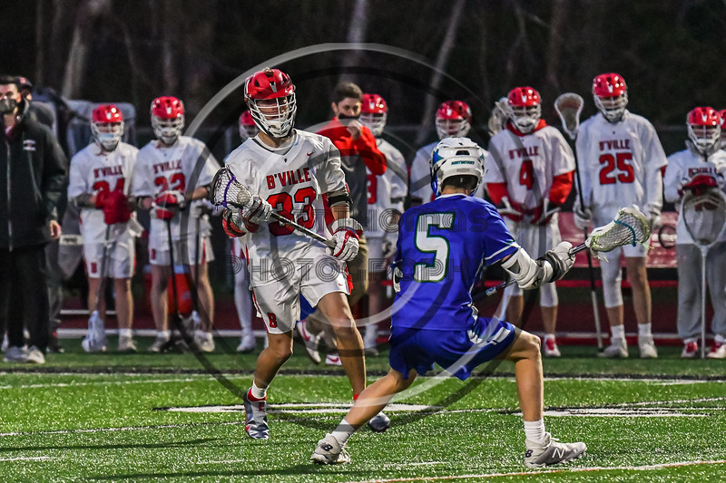 Baldwinsville Bees Trey Ordway (33) with the ball against Cicero-North Syracuse Northstars Reynolds Davis (5) in Section III Boys Lacrosse action at the Pelcher-Arcaro Stadium in Baldwinsville, New York on Tuesday, May 11, 2021. Baldwinsville won 17-6.