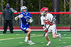 Baldwinsville Bees Carson Dyl (22) with the ball against  Cicero-North Syracuse Northstars Reynolds Davis (5) in Section III Boys Lacrosse action at the Pelcher-Arcaro Stadium in Baldwinsville, New York on Tuesday, May 11, 2021. Baldwinsville won 17-6.