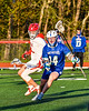 Cicero-North Syracuse Northstars Nolan Firth (14) with the ball against the Baldwinsville Bees in Section III Boys Lacrosse action at the Pelcher-Arcaro Stadium in Baldwinsville, New York on Tuesday, May 11, 2021. Baldwinsville won 17-6.