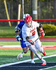 Baldwinsville Bees Austin McClintic (8) scoops up a ground ball against the Cicero-North Syracuse Northstars in Section III Boys Lacrosse action at the Pelcher-Arcaro Stadium in Baldwinsville, New York on Tuesday, May 11, 2021. Baldwinsville won 17-6.