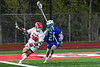 Baldwinsville Bees Michael Marsallo (29) with the ball against Cicero-North Syracuse Northstars Joseph Green (21) in Section III Boys Lacrosse action at the Pelcher-Arcaro Stadium in Baldwinsville, New York on Tuesday, May 11, 2021. Baldwinsville won 17-6.