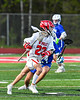 Baldwinsville Bees Colin Doyle (23) running with the ball against the Cicero-North Syracuse Northstars in Section III Boys Lacrosse action at the Pelcher-Arcaro Stadium in Baldwinsville, New York on Tuesday, May 11, 2021. Baldwinsville won 17-6.