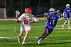Baldwinsville Bees Keegan Lynch (13) cradling the ball against Cicero-North Syracuse Northstars Nolan Firth (14) in Section III Boys Lacrosse action at the Pelcher-Arcaro Stadium in Baldwinsville, New York on Tuesday, May 11, 2021. Baldwinsville won 17-6.