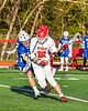 Baldwinsville Bees Lucas Hoskin (16) getting held by a Cicero-North Syracuse Northstars defender in Section III Boys Lacrosse action at the Pelcher-Arcaro Stadium in Baldwinsville, New York on Tuesday, May 11, 2021. Baldwinsville won 17-6.