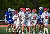 Baldwinsville Bees players congratulate Colin Socker (26) on his goal against the Cicero-North Syracuse Northstars in Section III Boys Lacrosse action at the Pelcher-Arcaro Stadium in Baldwinsville, New York on Tuesday, May 11, 2021. Baldwinsville won 17-6.