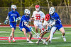 Baldwinsville Bees and Cicero-North Syracuse Northstars players battle over a ground ball in Section III Boys Lacrosse action at the Pelcher-Arcaro Stadium in Baldwinsville, New York on Tuesday, May 11, 2021. Baldwinsville won 17-6.