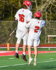 Baldwinsville Bees Lucas Hoskin (16) celebrates his goal against the Cicero-North Syracuse Northstars with Victor Ianno (2) in Section III Boys Lacrosse action at the Pelcher-Arcaro Stadium in Baldwinsville, New York on Tuesday, May 11, 2021. Baldwinsville won 17-6.