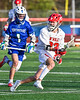 Baldwinsville Bees Colin Doyle (23) protecing the ball against Cicero-North Syracuse Northstars Elijah Martin (1) in Section III Boys Lacrosse action at the Pelcher-Arcaro Stadium in Baldwinsville, New York on Tuesday, May 11, 2021. Baldwinsville won 17-6.