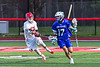 Baldwinsville Bees Austin McClintic (8) defending against Cicero-North Syracuse Northstars Anthony Cimino (17) in Section III Boys Lacrosse action at the Pelcher-Arcaro Stadium in Baldwinsville, New York on Tuesday, May 11, 2021. Baldwinsville won 17-6.