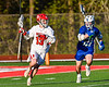 Baldwinsville Bees Keegan Lynch (13) cradling the ball against Cicero-North Syracuse Northstars Joseph Green (21) in Section III Boys Lacrosse action at the Pelcher-Arcaro Stadium in Baldwinsville, New York on Tuesday, May 11, 2021. Baldwinsville won 17-6.