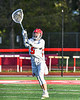 Baldwinsville Bees goalie Cooper Foote (5) passing the ball against the Cicero-North Syracuse Northstars in Section III Boys Lacrosse action at the Pelcher-Arcaro Stadium in Baldwinsville, New York on Tuesday, May 11, 2021. Baldwinsville won 17-6.