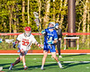Baldwinsville Bees Trey Ordway (33) knocked the ball away from Cicero-North Syracuse Northstars Nolan Firth (14) in Section III Boys Lacrosse action at the Pelcher-Arcaro Stadium in Baldwinsville, New York on Tuesday, May 11, 2021. Baldwinsville won 17-6.