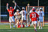 Baldwinsville Bees Ryan Hollenbeck (17) celebrates the goal by Bees Victor Ianno (2, on the ground) against the Liverpool Warriors in Section III Boys Lacrosse action at Liverpool High School Stadium in Liverpool, New York on Thursday, May 13, 2021. Baldwinsville won 17-3.