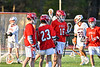 Baldwinsville Bees players congratulate Lucas Hoskin (16) on his goal against the Liverpool Warriors in Section III Boys Lacrosse action at Liverpool High School Stadium in Liverpool, New York on Thursday, May 13, 2021. Baldwinsville won 17-3.