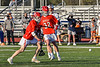 Baldwinsville Bees Carson Dyl (22) drives and scores a goal against the Liverpool Warriors in Section III Boys Lacrosse action at Liverpool High School Stadium in Liverpool, New York on Thursday, May 13, 2021. Baldwinsville won 17-3.