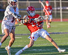 Baldwinsville Bees Colin Doyle (23) getting held by  Liverpool Warriors Dominick Osbeck (11) in Section III Boys Lacrosse action at Liverpool High School Stadium in Liverpool, New York on Thursday, May 13, 2021. Baldwinsville won 17-3.