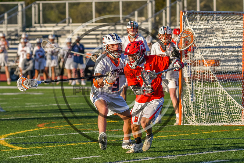 Baldwinsville Bees Victor Ianno (2) being defended by Liverpool Warriors Owen Atchie (9) in Section III Boys Lacrosse action at Liverpool High School Stadium in Liverpool, New York on Thursday, May 13, 2021. Baldwinsville won 17-3.