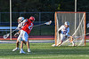 Baldwinsville Bees Colin Socker (26) shoots and scores a goal against Liverpool Warriors Owen Atchie (9) and goalie Owen Salanger (17) in Section III Boys Lacrosse action at Liverpool High School Stadium in Liverpool, New York on Thursday, May 13, 2021. Baldwinsville won 17-3.