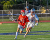 Baldwinsville Bees Colin Doyle (23) with the ball against Liverpool Warriors Gavin Kenna (31) in Section III Boys Lacrosse action at Liverpool High School Stadium in Liverpool, New York on Thursday, May 13, 2021. Baldwinsville won 17-3.