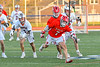 Baldwinsville Bees Jacob Czyz (7) retrieves the ball after a face-off against the Liverpool Warriors in Section III Boys Lacrosse action at Liverpool High School Stadium in Liverpool, New York on Thursday, May 13, 2021. Baldwinsville won 17-3.