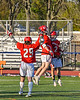 Baldwinsville Bees Michael Marsallo (29) and Victor Ianno (2) celebrate a goal by Carson Dyl (22) against the Liverpool Warriors in Section III Boys Lacrosse action at Liverpool High School Stadium in Liverpool, New York on Thursday, May 13, 2021. Baldwinsville won 17-3.
