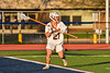 Liverpool Warriors Gianpaul Cooper (27) looking to make a play against the Baldwinsville Bees in Section III Boys Lacrosse action at Liverpool High School Stadium in Liverpool, New York on Thursday, May 13, 2021. Baldwinsville won 17-3.