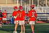 Baldwinsville Bees players Leo Johnson (3) and Trey Ordway (33) congratulate Keegan Lynch (13) on his goal against the Liverpool Warriors in Section III Boys Lacrosse action at Liverpool High School Stadium in Liverpool, New York on Thursday, May 13, 2021. Baldwinsville won 17-3.