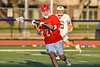 Baldwinsville Bees Brayden Penafeather-Stevenson (21) looking to make a pass against the Liverpool Warriors in Section III Boys Lacrosse action at Liverpool High School Stadium in Liverpool, New York on Thursday, May 13, 2021. Baldwinsville won 17-3.