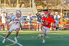 Baldwinsville Bees John Morrissey (18) defending against Liverpool Warriors Joseph Sacco (1) in Section III Boys Lacrosse action at Liverpool High School Stadium in Liverpool, New York on Thursday, May 13, 2021. Baldwinsville won 17-3.