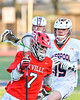 Baldwinsville Bees Jacob Czyz (7) with the ball against a Liverpool Warriors defender in Section III Boys Lacrosse action at Liverpool High School Stadium in Liverpool, New York on Thursday, May 13, 2021. Baldwinsville won 17-3.