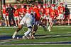 Baldwinsville Bees Jacob Czyz (7) facing off against Liverpool Warriors Jalen Graham (12) to start a Section III Boys Lacrosse game at Liverpool High School Stadium in Liverpool, New York on Thursday, May 13, 2021. Baldwinsville won 17-3.