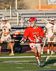 Baldwinsville Bees Trey Ordway (33) with the ball and looking to make a play against the Liverpool Warriors in Section III Boys Lacrosse action at Liverpool High School Stadium in Liverpool, New York on Thursday, May 13, 2021. Baldwinsville won 17-3.