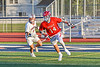 Baldwinsville Bees Tucker Macknik (14) running with the ball against the Liverpool Warriors in Section III Boys Lacrosse action at Liverpool High School Stadium in Liverpool, New York on Thursday, May 13, 2021. Baldwinsville won 17-3.