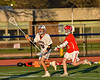 Liverpool Warriors Nicolas Toscano (20) passing the ball against Baldwinsville Bees Keegan Lynch (13) in Section III Boys Lacrosse action at Liverpool High School Stadium in Liverpool, New York on Thursday, May 13, 2021. Baldwinsville won 17-3.