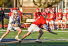 Baldwinsville Bees Jacob Czyz (7) wins a face-off against Liverpool Warriors Jalen Graham (12) in Section III Boys Lacrosse action at Liverpool High School Stadium in Liverpool, New York on Thursday, May 13, 2021. Baldwinsville won 17-3.